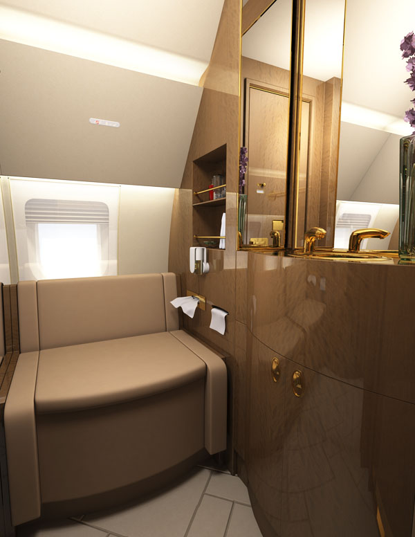 Bathroom aircraft rendering with luxury fittings and convertible seat toilet.