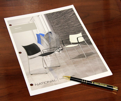 Photo of printed Upwards Brochure with stills from finished furniture animation.