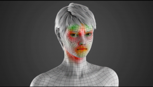 This is a 3D rendered image of the model from the facial animation in the middle of an intense facial expression. There are red and green colors on the face of the model indicating where the tension is in the face and where the wrinkles would occur.