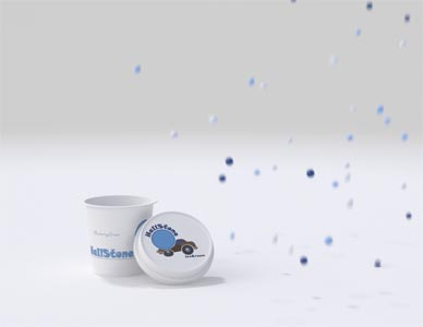 A still rendering from the commercial showing the empty ice cream container and the falling stones appearing from the right.