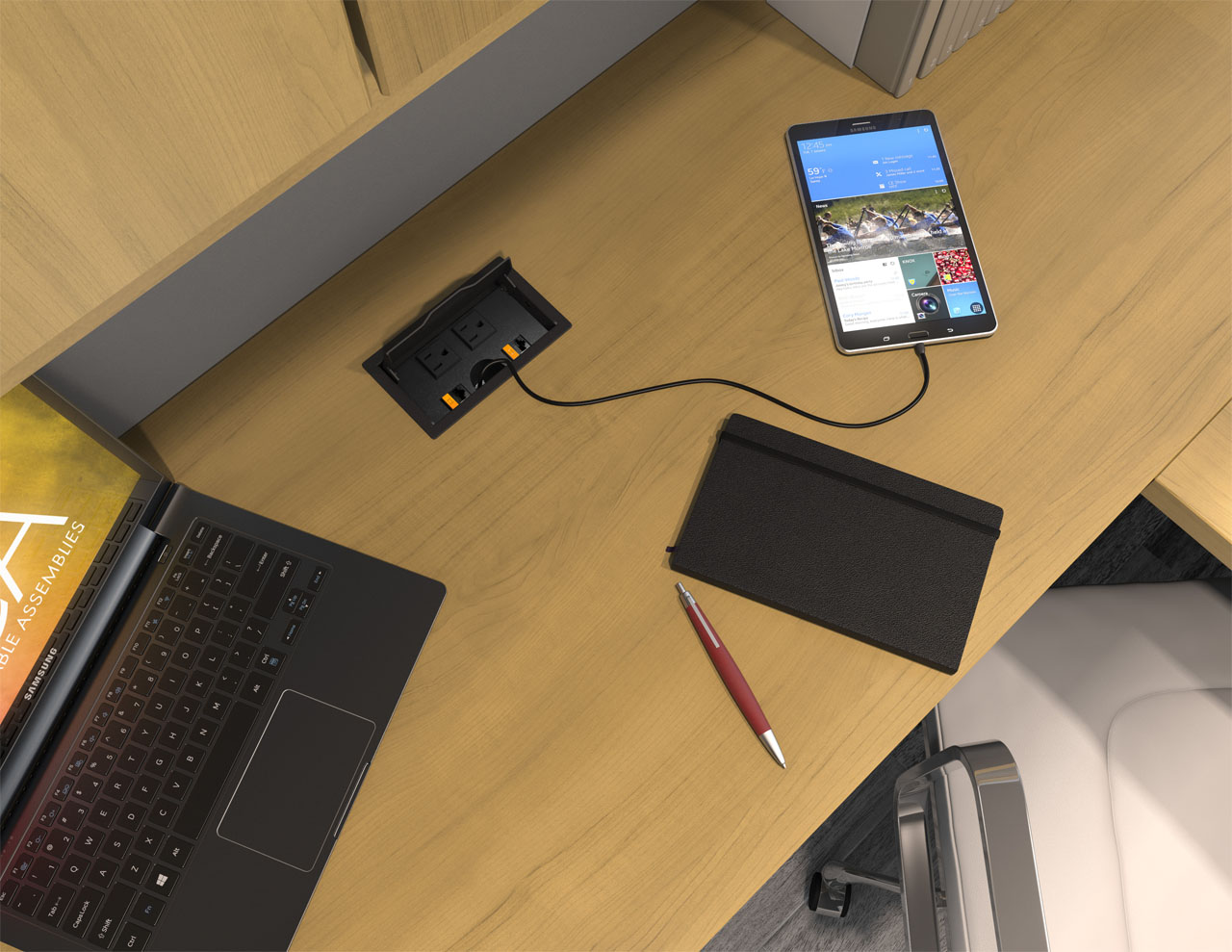 Top view rendering of a cubicle workspace with a flip top style ECA power hub providing power to devices on the desk.