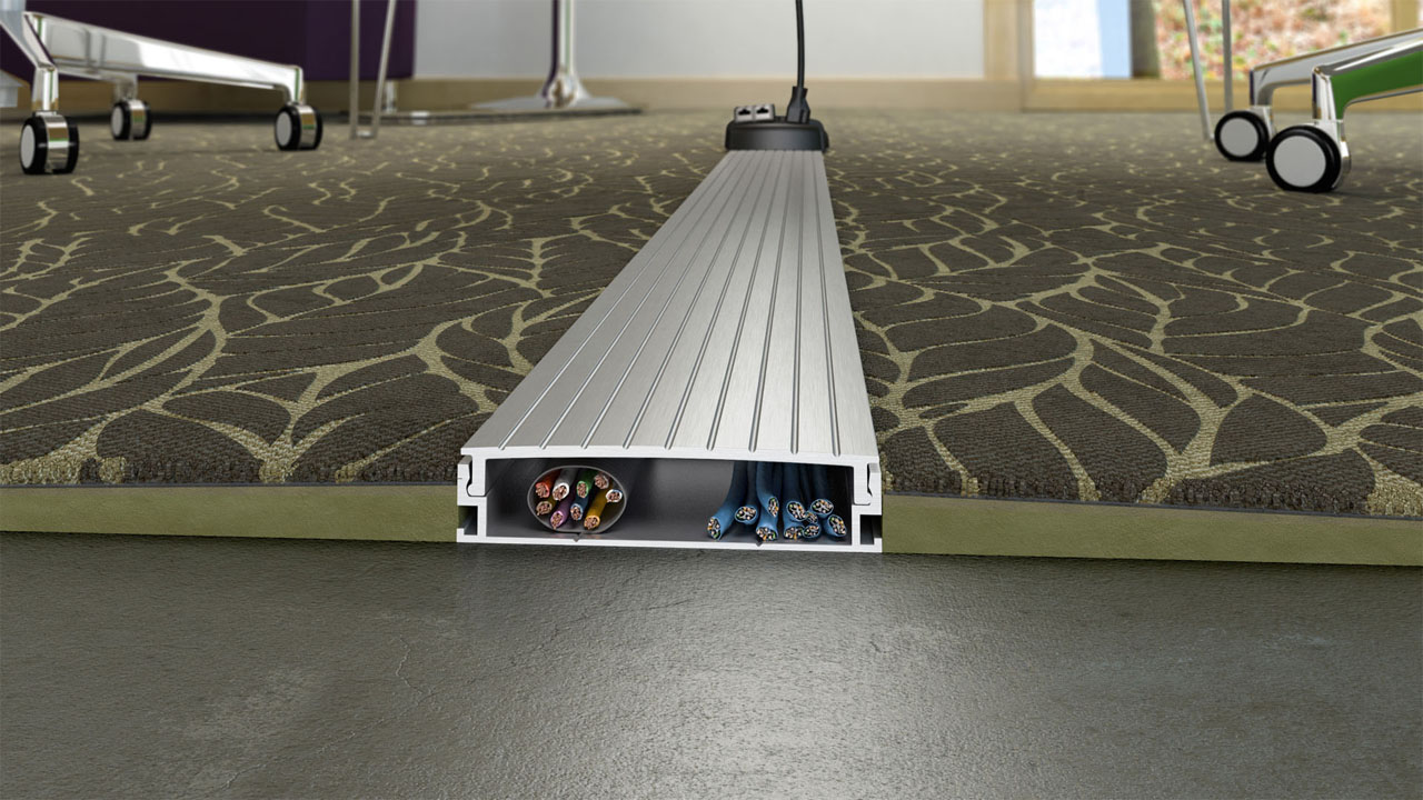A cross section rendering of a cable management channel running under a carpeted floor, showing the internal cables.