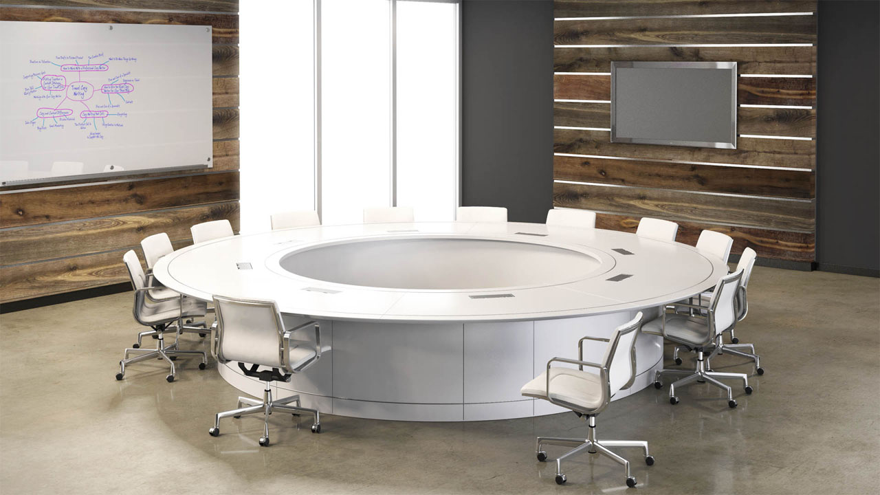 A rendering of a large circular white meeting table in a business conference room with whiteboard and projection screen.