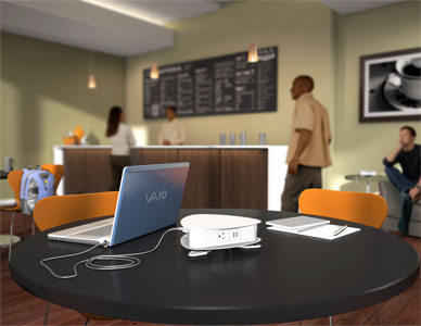 Computer generated rendering of a coffee shop environment with a table top power system in the foreground powering a laptop computer.