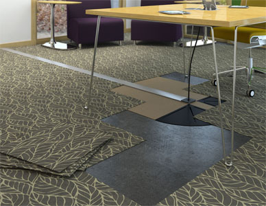 Computer rendering of a partially installed wireway in a college commons area, showing carpet tiles that can overlay the wire management hardware.