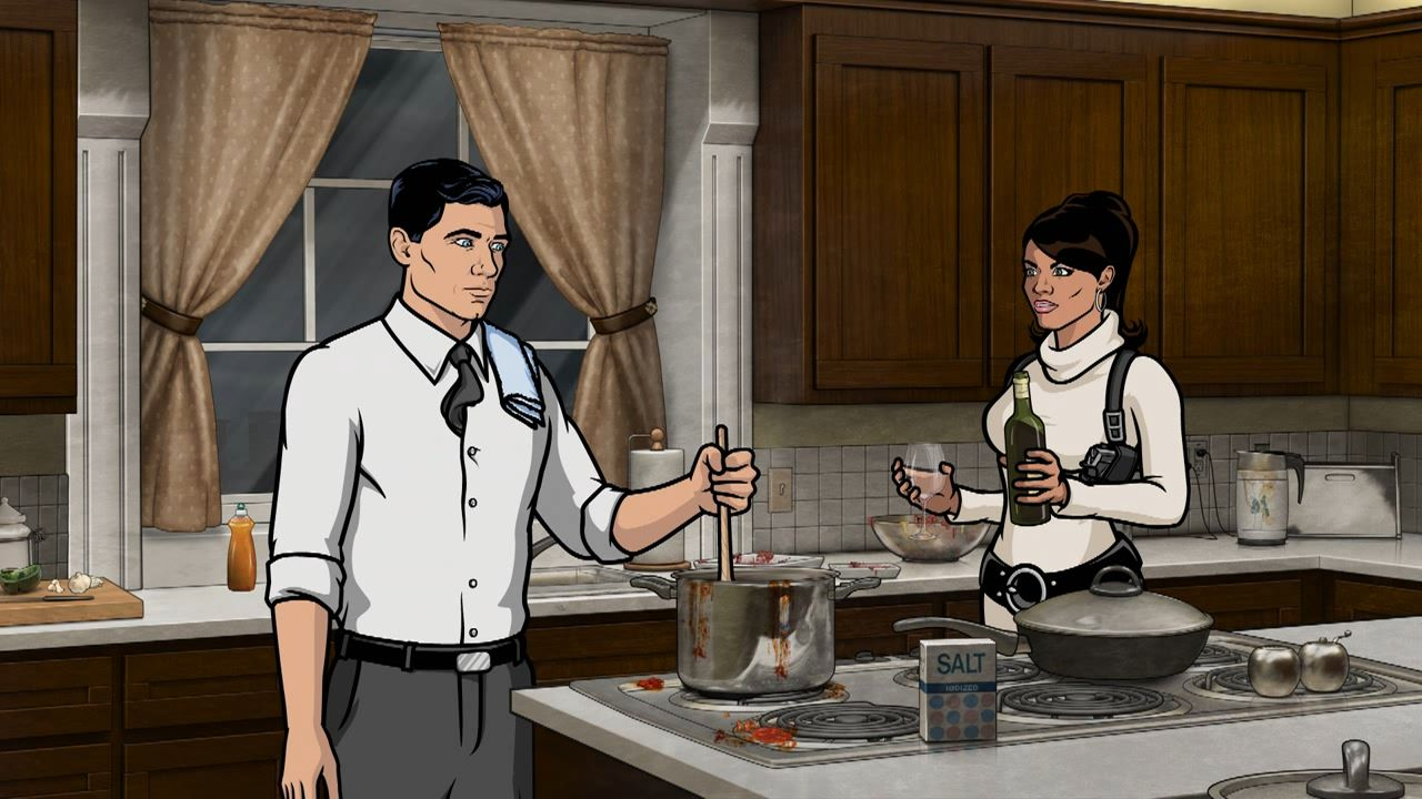 Archer and Lana cooking. With wine!